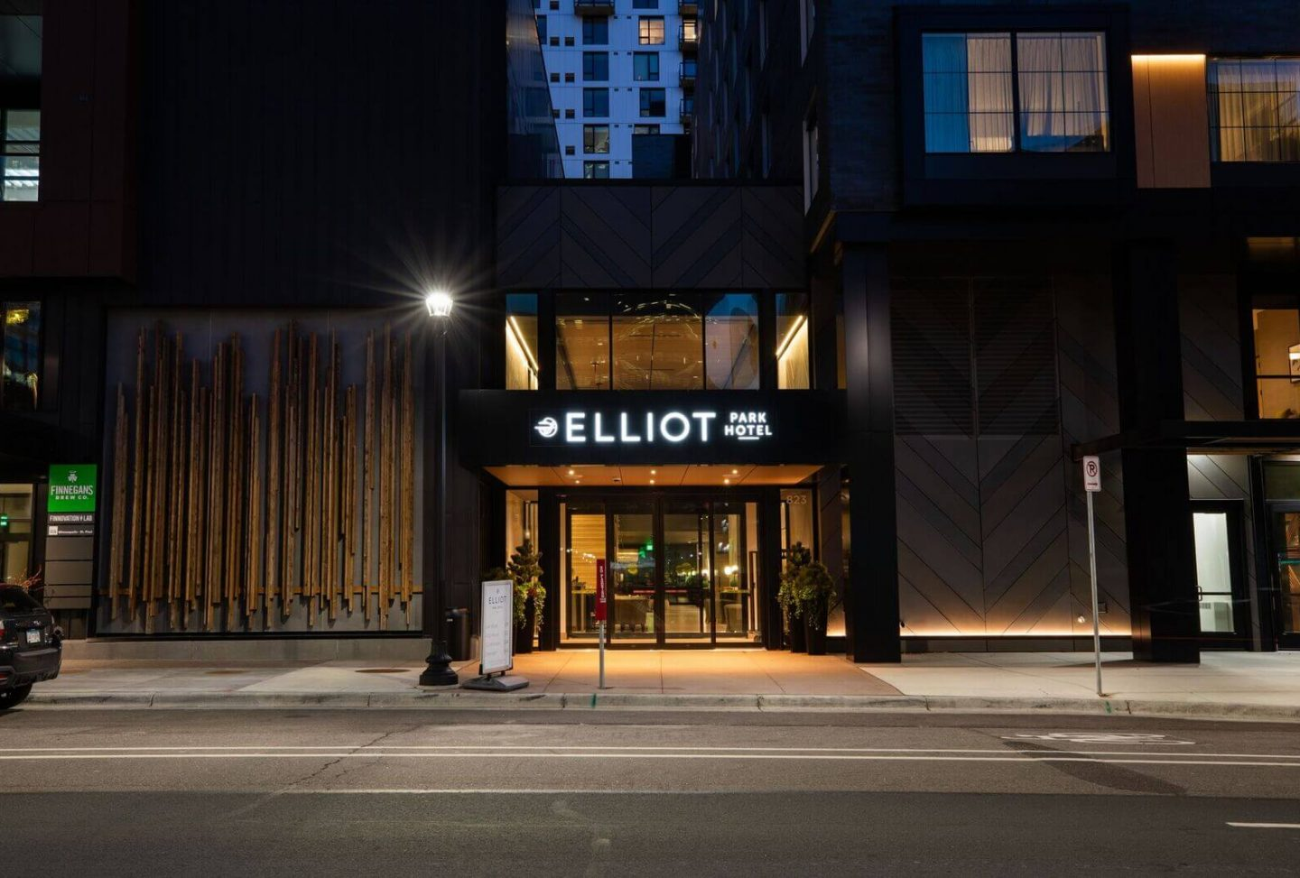 View of entrance to Elliot Park Hotel at night